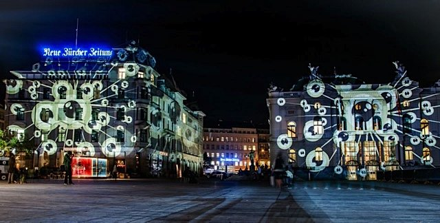 The Golden Eye Icon of the Zurich Film Festival spotlighted on two of the historic buildings in Zurich